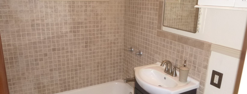 New ceramic tiles in a small bathroom.
